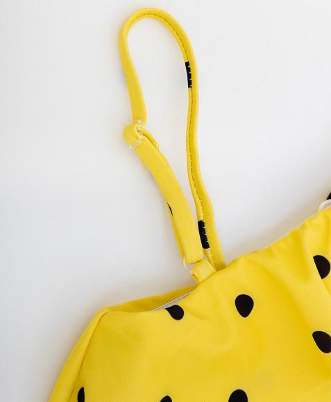 Желтый купальник в горошек